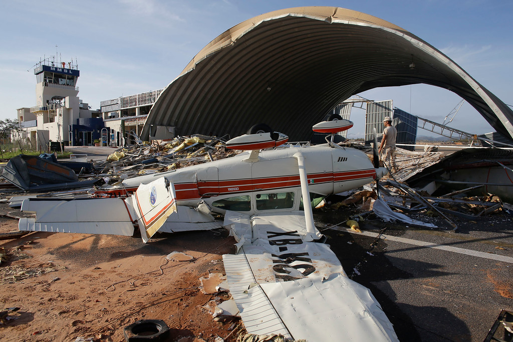 . A plane destroyed by Hurricane Odile sits overturned at the airport in Cabo San Lucas, Mexico, Wednesday, Sept. 17, 2014. Odile blazed a trail of destruction through Mexico\'s Baja California Peninsula that leveled everything from ramshackle homes to luxury hotels. Water and electricity service remained out and phone service was intermittent Thursday. Federal Electricity Commission officials said some 2,500 power poles were toppled by Odile, which struck late Sunday as a Category 3 storm. (AP Photo/Victor R. Caivano)