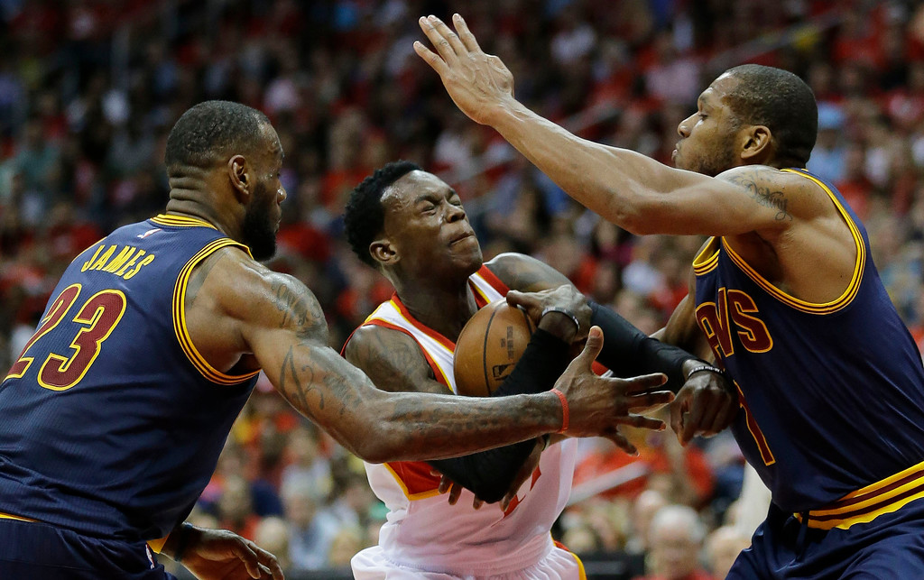 . Atlanta Hawks guard Dennis Schroder (17) runs into Cleveland Cavaliers\' LeBron James (23) and James Jones (1) during the first half in Game 2 of the Eastern Conference finals of the NBA basketball playoffs, Friday, May 22, 2015, in Atlanta. (AP Photo/David Goldman)