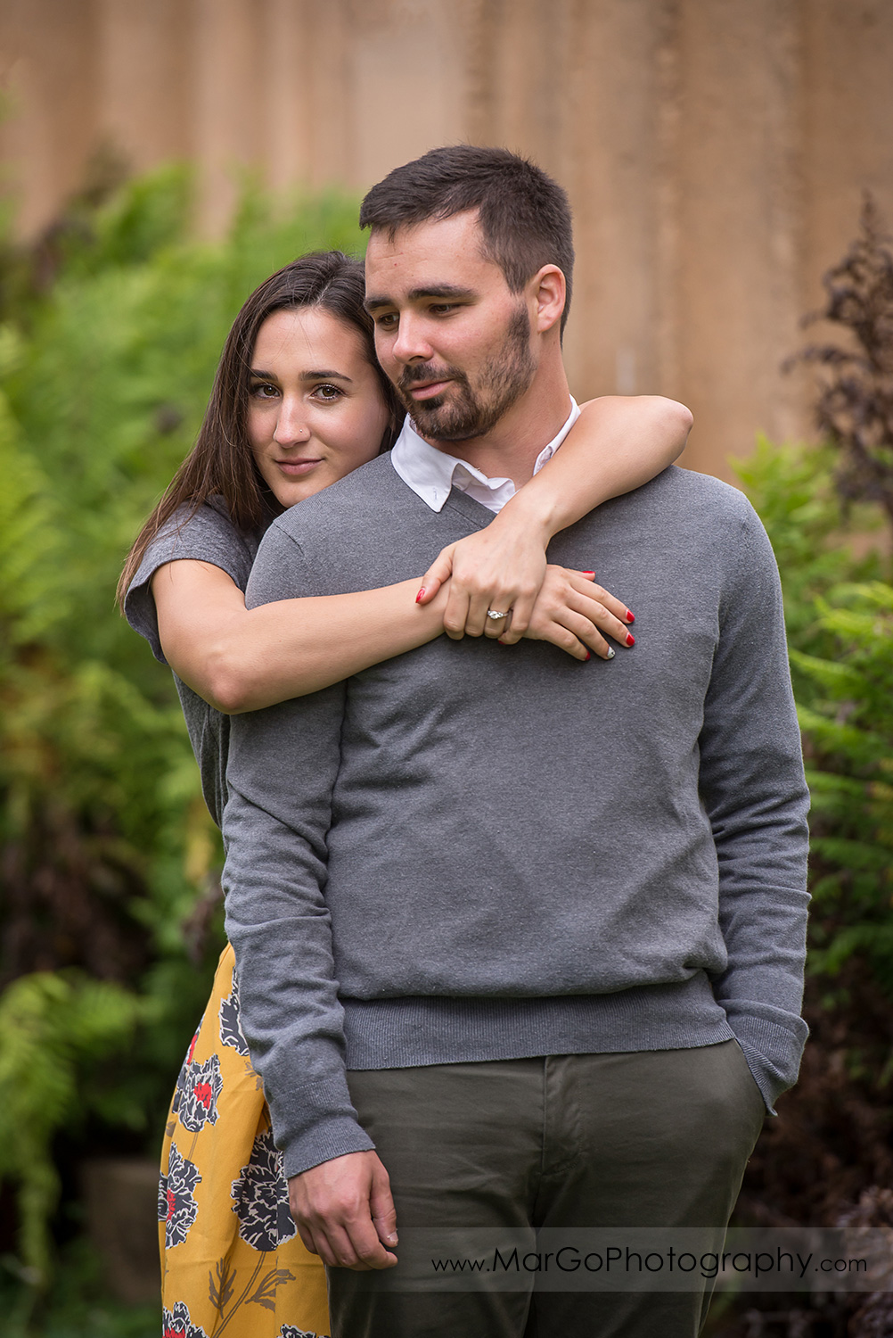 engagement session at Palace of Fine Arts in San Francisco - hugging couple