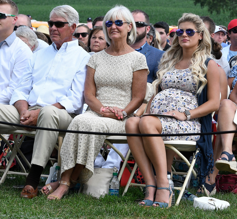 . Chipper Jones\' family, left to right, father Larry Wayne Jones, Sr., mother Lynne Jones and his wife Taylor Jones watch his induction speech on Sunday, July 29, 2018, at the Baseball Hall of Fame Induction in Cooperstown, N.Y. (AP Photo/Hans Pennink)