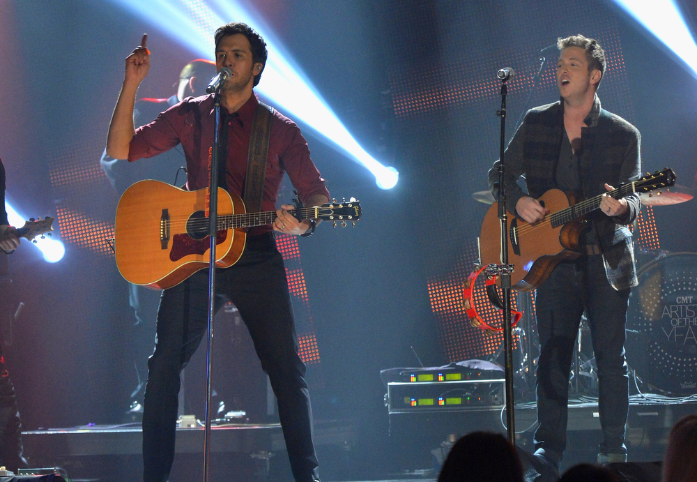. Luke Bryan and Ryan Tedder perform onstage during the 2012 CMT Artists Of The Year at The Factory at Franklin on December 3, 2012 in Franklin, Tennessee.  (Photo by Rick Diamond/Getty Images for CMT)
