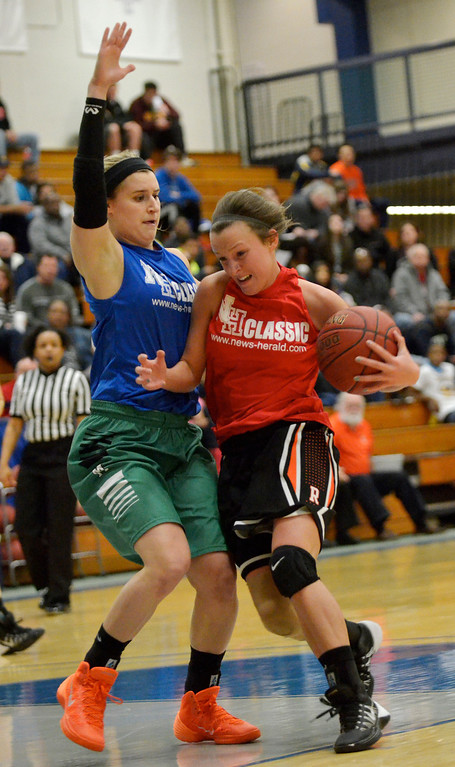 . Jeff Forman/JForman@News-Herald.com Steph Chlad, Red, drives past Shannon Zajec during the 36th News-Herald Classic March 29 at Lakeland Community College.