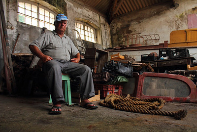 Manuel Garcia Tavares Jr., a former worker at the Porto Pim Whaling Factory in Horta, Faial, pictured among the remnants of the whaling industry at the Reis e Martins warehouse. August 3, 2012.