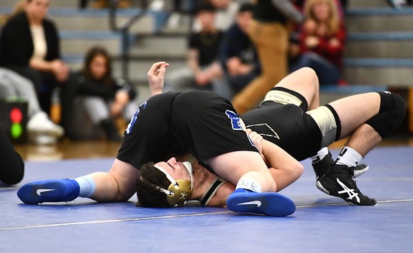 12/27/2019 Mike Orazzi | StaffrBristol Eastern High School sophomore Ella Nichols pins a Trumbull wrestler during Friday night's match in Bristol.