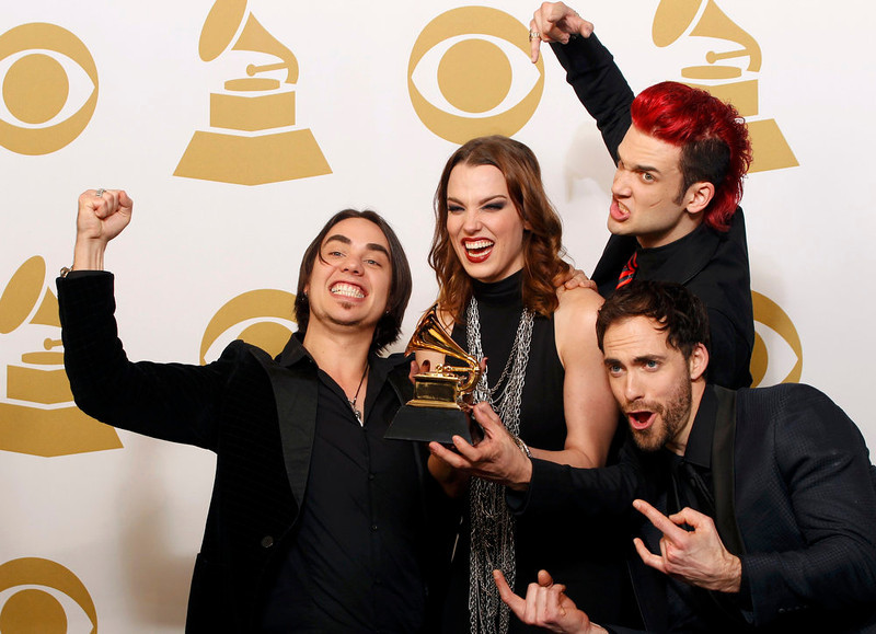 ". Halestorm pose with their Grammy award for Best Hard Rock/Metal Performance for ""Love Bites (So Do I)\"" backstage at the 55th annual Grammy Awards in Los Angeles, California February 10, 2013.   REUTERS/Jonathan Alcorn"