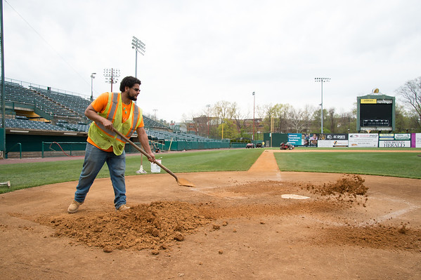 05/02/19 Wesley Bunnell | Staff Work at New Britain Stadium is underway getting the field in shape for Friday's upcoming New Britain Bees home opener. New Britain Public Works employee Alberto Vega spreads around new clay to be worked into the area around home plate.