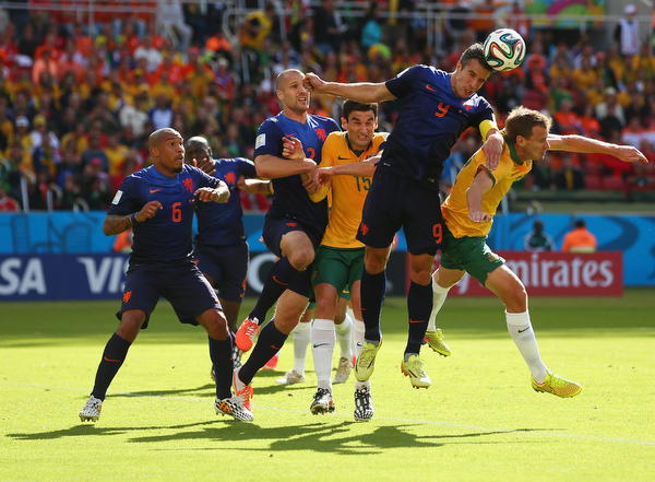 . Robin van Persie of the Netherlands goes up for header during the 2014 FIFA World Cup Brazil Group B match between Australia and Netherlands at Estadio Beira-Rio on June 18, 2014 in Porto Alegre, Brazil.  (Photo by Quinn Rooney/Getty Images)