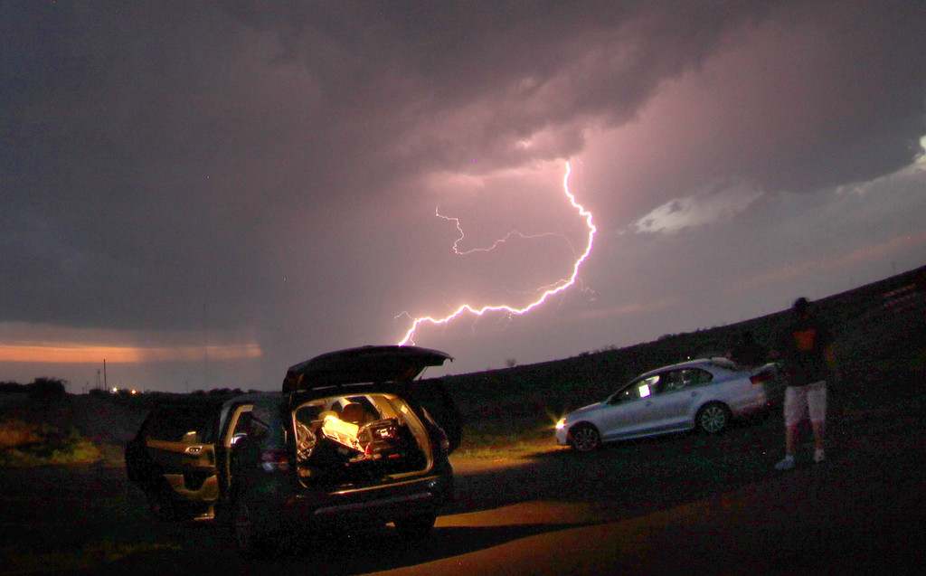 . April 26,2014. Quaniah TX. USA. Lightning strikes across as storm chasers take photos and track the atoms as they move over the Midwest.