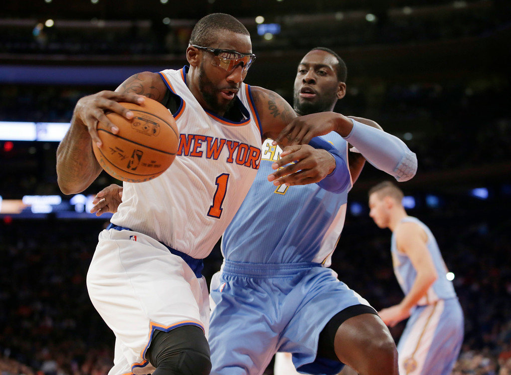 . Denver Nuggets center J.J. Hickson (7) defends New York Knicks forward Amar\'e Stoudemire (1) in the second half of an NBA basketball game at Madison Square Garden in New York, Sunday, Nov. 16, 2014.  The Knicks defeated the Nuggets 109-93. (AP Photo/Kathy Willens)