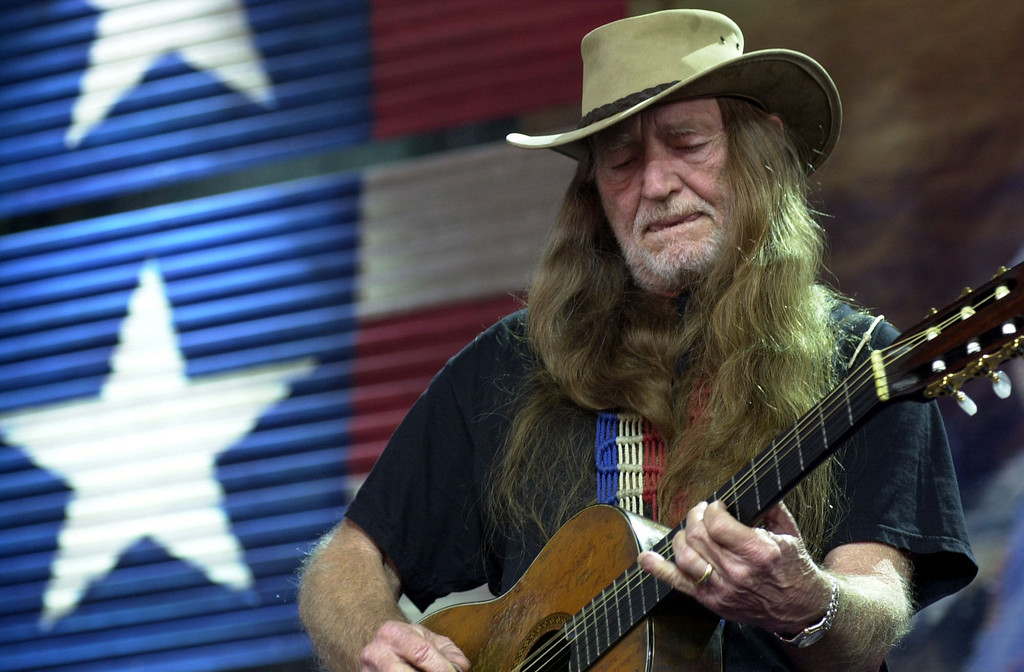 . Willie Nelson performs at Farm Aid 2002 in Burgettstown, Pa., Saturday, Sept. 21, 2002. (AP Photo/Jasmine Gehris)