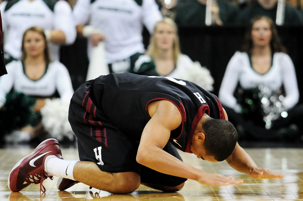 . SPOKANE, WA - MARCH 22:  Siyani Chambers #1 of the Harvard Crimson reacts after turning the ball over late in the second half against the Michigan State Spartans during the Third Round of the 2014 NCAA Basketball Tournament at Spokane Veterans Memorial Arena on March 22, 2014 in Spokane, Washington.  (Photo by Steve Dykes/Getty Images)