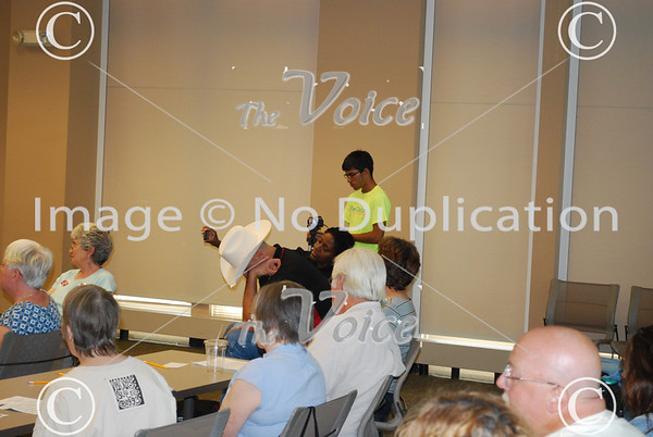 Northern Illinois Jobs with Justice at Batavia, IL Public Library discussion about Middle Class under fire 7-21-12