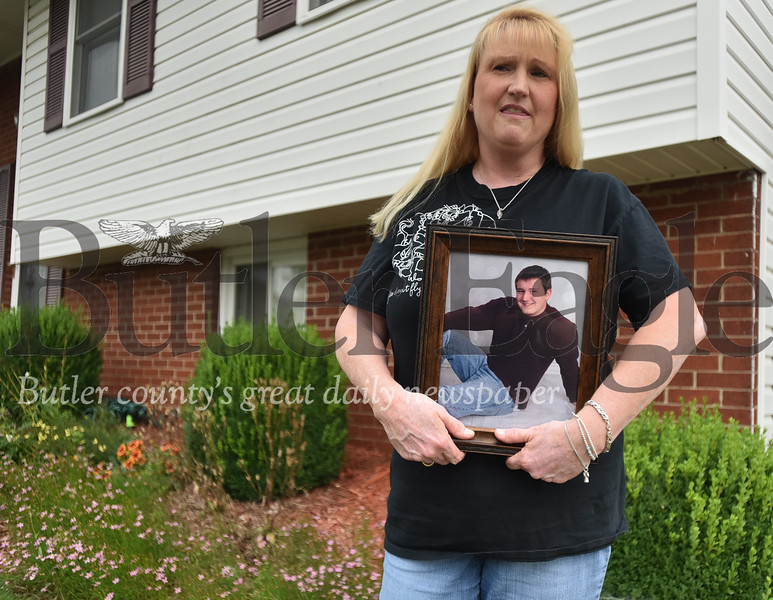 86261 Dorrie Pacoe holds photos of her son Alex Pacoe who died from a overdose in january of 2017