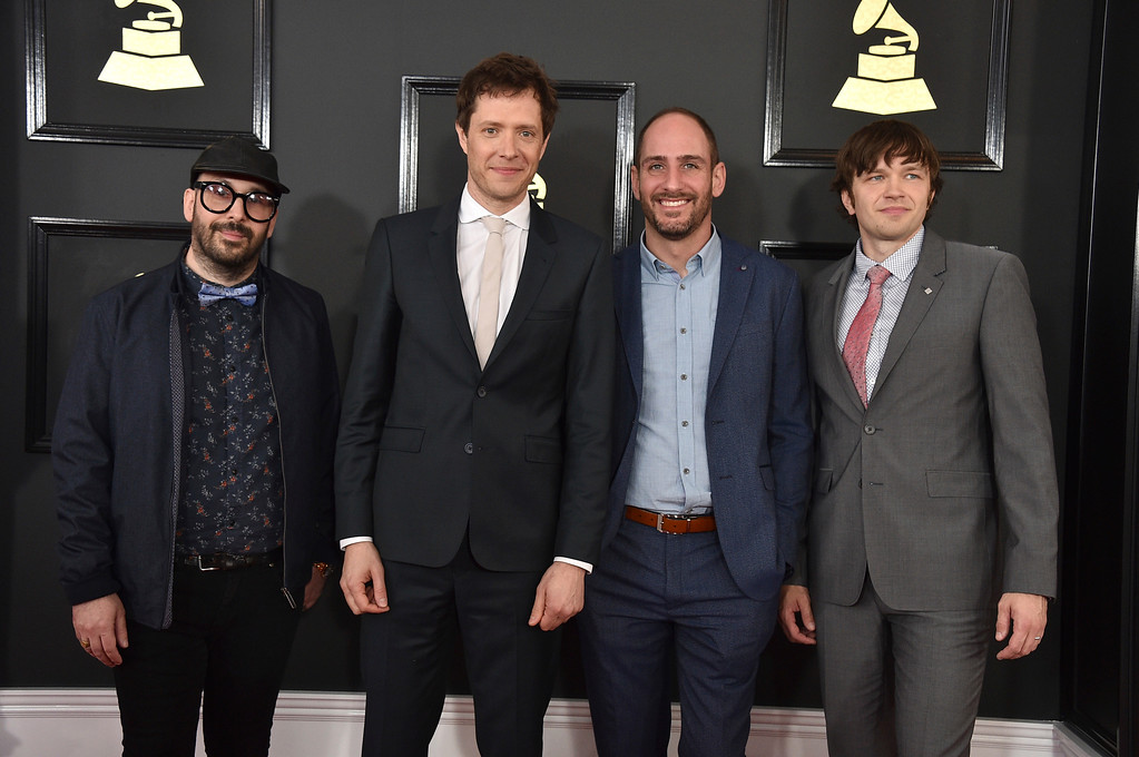 . Tim Nordwind, from left, Damian Kulash, Dan Konopka, and Andy Ross of the musical group OK Go arrive at the 59th annual Grammy Awards at the Staples Center on Sunday, Feb. 12, 2017, in Los Angeles. (Photo by Jordan Strauss/Invision/AP)