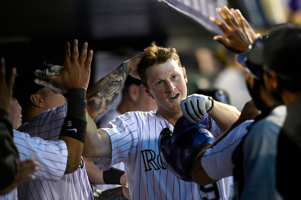 . Colorado Rockies DJ LeMahieu (9) is congratulated by teammates in the dugout after hitting a home run in the 5th inning against the Arizona Diamondbacks June 3, 2014 at Coors Field. (Photo by John Leyba/The Denver Post)