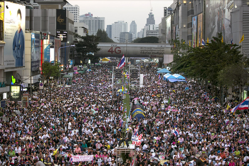 . Anti-government  protestors occupy a downtown intersection during the first day of a mass demonstration on January 13, 2014 in Bangkok, Thailand. Fear of more violence and instability as the anti-government protesters move forward in an attempt to shutdown Bangkok by blocking major intersections in the heart of the city in their long running campaign to oust the government of Prime Minister Yingluck Shinawatra. Thailand\'s political crisis has continued for months with elections going ahead on February 2nd. ( Photo by Paula Bronstein/Getty Images)