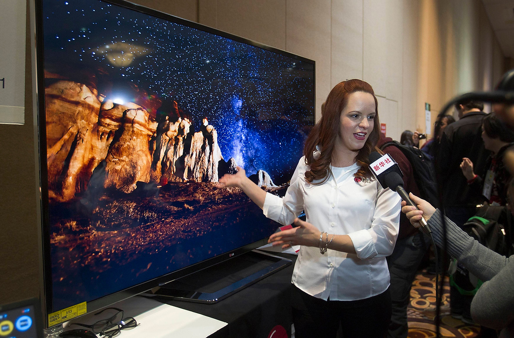 . Nitza Martinez shows off an 84-inch Ultra HD LED television by LG Electronics at the opening press event of the Consumer Electronics Show (CES) in Las Vegas January 6, 2013. The retail price for the television is $19,999.99. (REUTERS/Steve Marcus)