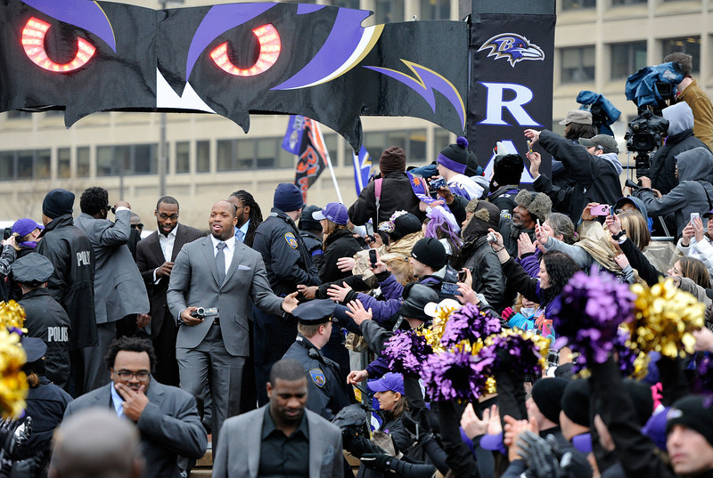 . Baltimore Ravens linebacker Terrell Suggs and receiver Anquan Boldin, back, arrive at a send-off rally Monday, Jan. 28, 2013 in Baltimore. The team was leaving for New Orleans to play against the San Francisco 49ers in the Super Bowl. (AP Photo/Steve Ruark)