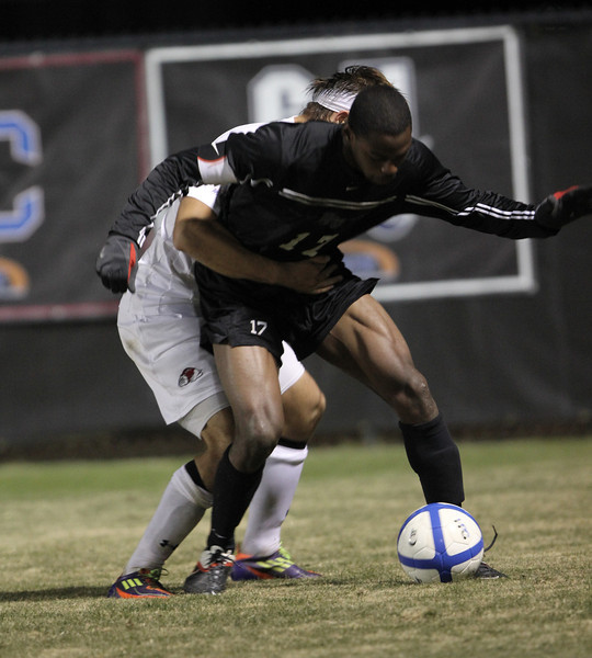GWU's number 21, Eric Yeager, battles for the ball.