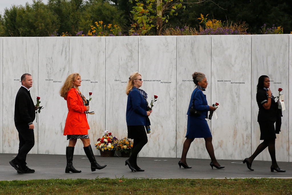 . Family and friends of the 40 passengers and crew of Flight 93 walk past the Wall of Names at the Flight 93 National Memorial in Shanksville, Pa., as they arrive for a Service of Remembrance Thursday, Sept. 11, 2014. (AP Photo/Gene J. Puskar)