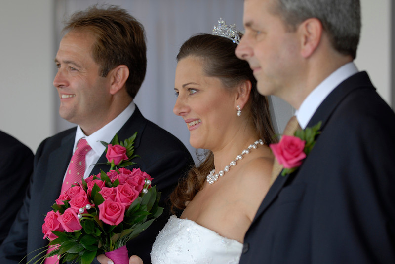 Bride and Groom photographed during the wedding ceremony in Sandbanks,Dorset