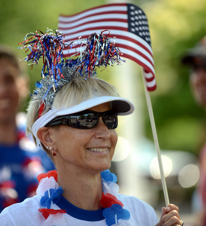 . A spectator is colorfully attired in red, white and blue for the parade. (Pioneer Press: Chris Polydoroff)