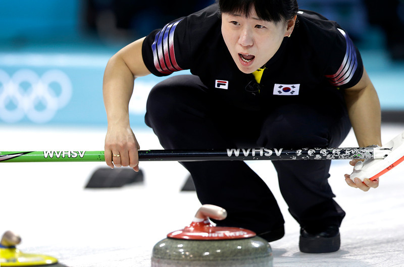. South Korea\'s Shin Mi-sung shouts instructions to her teammates during the women\'s curling competition against Japan at the 2014 Winter Olympics, Tuesday, Feb. 11, 2014, in Sochi, Russia. (AP Photo/Wong Maye-E)