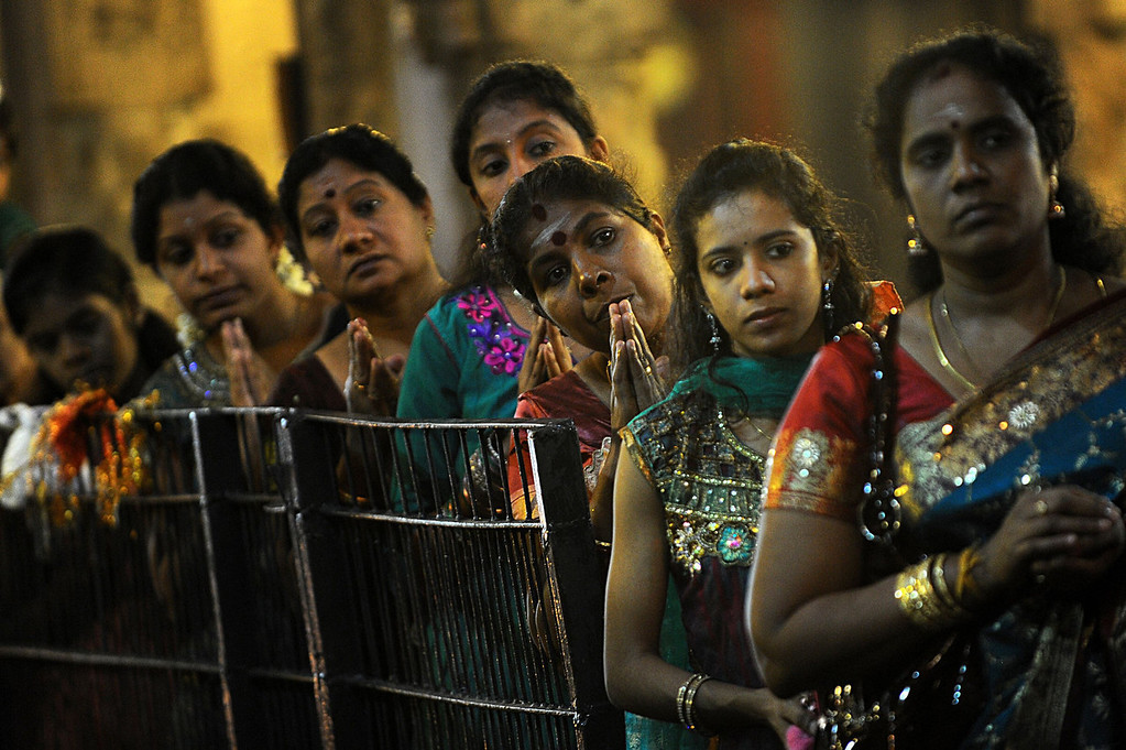 . Sri Lankan Tamil devotees offer prayers during Diwali, or the Festival of Lights at a Hindu temple in Colombo on November 2, 2013. The Hindu Festival of Lights, Diwali marks the homecoming of the God Lord Ram after vanquishing the demon king Ravana and symbolizes taking people from darkness to light in the victory of good over evil.  Ishara S.KODIKARA/AFP/Getty Images