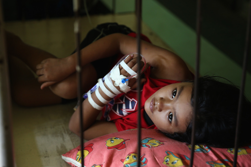 . A young girl lies in a bed awaiting treatment in Tacloban Hospital on November 15, 2013 in Leyte, Philippines.   (Photo by Dan Kitwood/Getty Images)