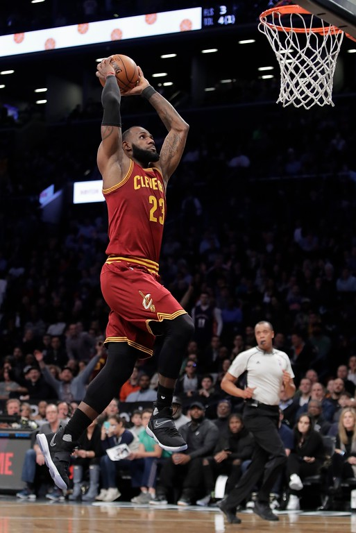 . Cleveland Cavaliers\' LeBron James (23) dunks during the first half of an NBA basketball game against the Brooklyn Nets, Friday, Jan. 6, 2017, in New York. (AP Photo/Frank Franklin II)