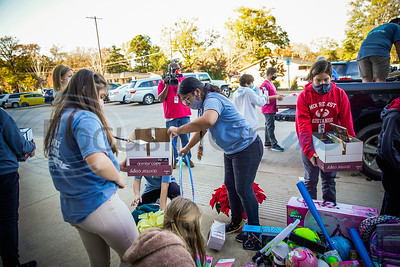 Moore Middle School Student Council Donates To Toys For Tots by Michel Alfaro