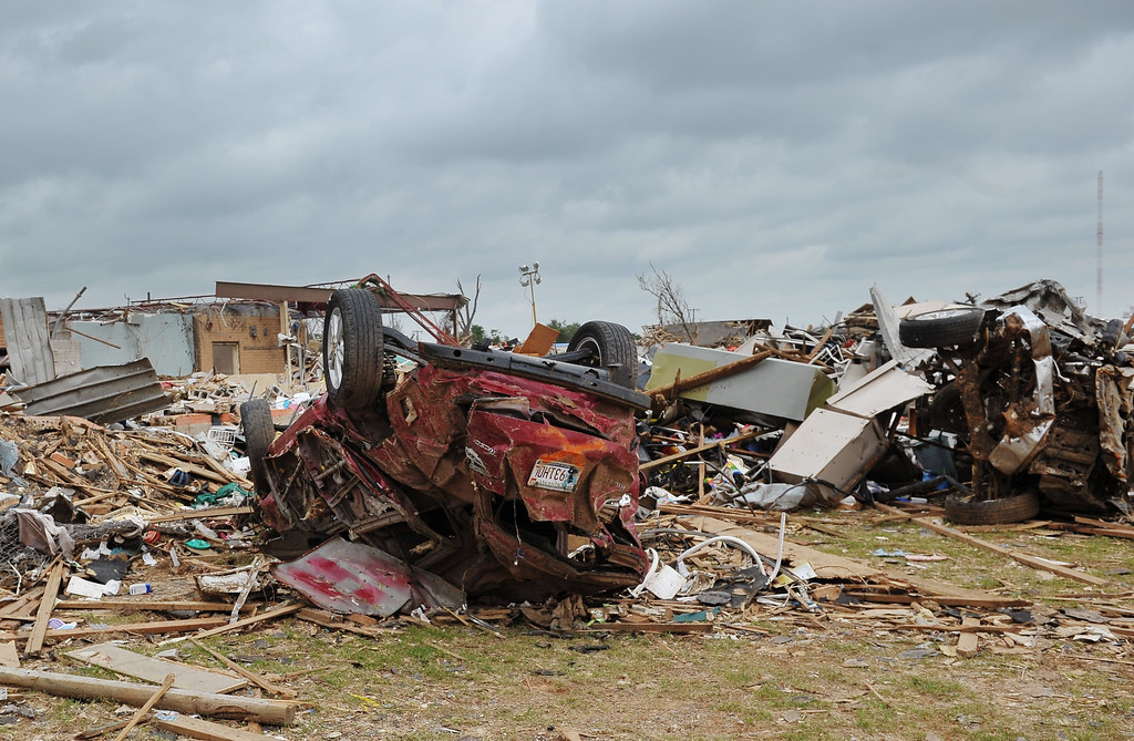 . An overturned car is seen near the tornado affected Plaza Towers Elementary School on May 26, 2013 in Moore, Oklahoma.  US President Barack Obama offered solace and support to residents of Oklahoma on Sunday as they rebuild their shattered lives after a monster tornado killed 24 people.     MANDEL NGAN/AFP/Getty Images