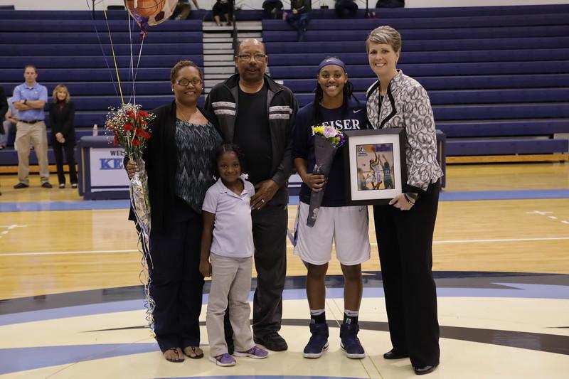 Keiser senior Miah Shephard and family with Coach Oswald