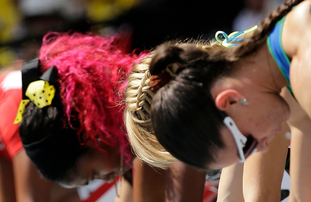 . Brazil\'s Franciela Krasucki, Ukraine\'s Nataliya Pohrebnyak and Jamaica\'s Shelly-Ann Fraser-Pryce start in a women\'s 100-meter heat at the World Athletics Championships in the Luzhniki stadium in Moscow, Russia, Sunday, Aug. 11, 2013. (AP Photo/David J. Phillip)