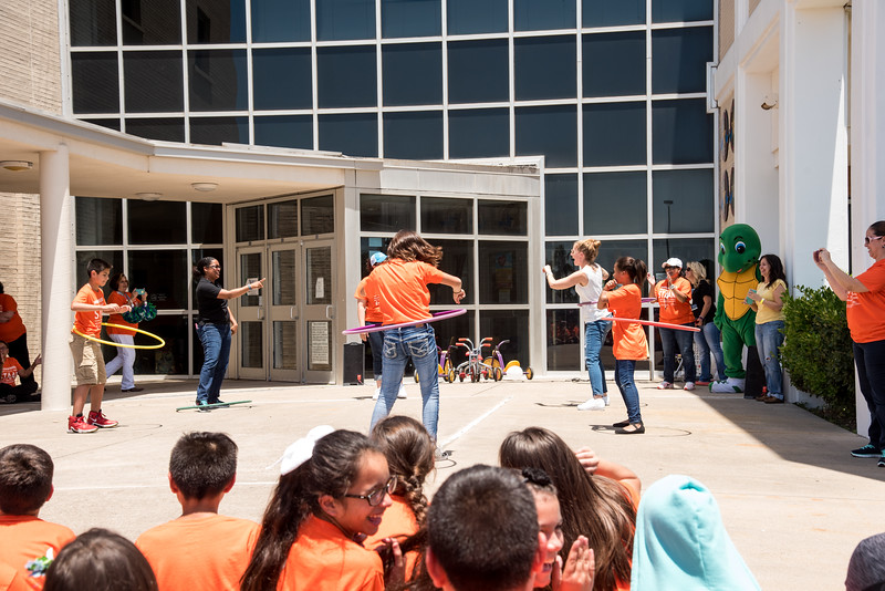 teachers and students over at the ECDC pep rally compete in hulla hoop
