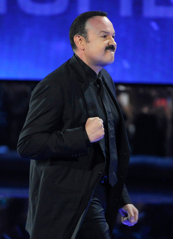 """. Pepe Aguilar gestures as he walks on stage to accept the award for best ranchero album for \""""Lastima Que Sean Ajenas\"""" at the 15th annual Latin Grammy Awards at the MGM Grand Garden Arena on Thursday, Nov. 20, 2014, in Las Vegas. (Photo by Chris Pizzello/Invision/AP)"""