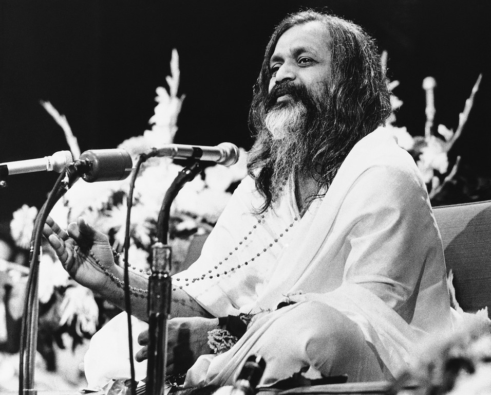 """. Marharishi Mahesh Yogi, an Indian guru, finger his beads as he lectures students on \""""Transcendental Meditation\"""" at the Harvard Law School Forum on Jan. 22, 1968 in Cambridge, Massachusetts. His holiness, tutor to the Beatles and thousands of other believers in the benefits of meditation, heads a cult, the hindu order of Shankarachary, from headquaters in India. (AP Photo)"""