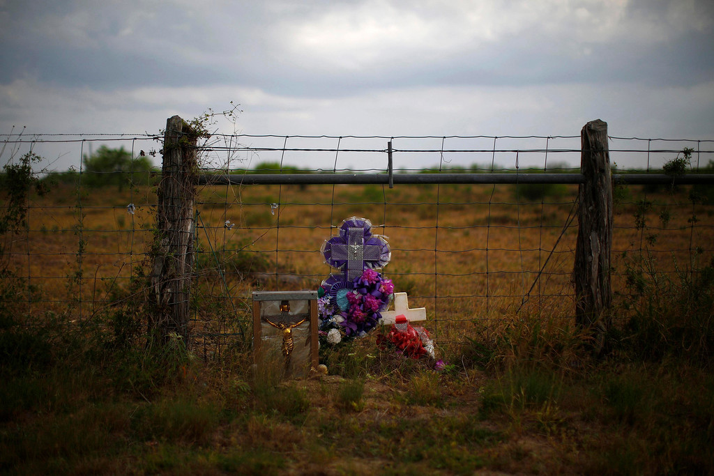 ". A memorial is seen in the desert near Falfurrias, Texas April 2, 2013. Brooks County has become an epicentre for illegal immigrant deaths in Texas. In 2012, sheriff\'s deputies found 129 bodies there, six times the number recorded in 2010. Most of those who died succumbed to the punishing heat and rough terrain that comprise the ranch lands of south Texas. Many migrants spend a few days in a ""stash house\"", such as the Casa del Migrante, in Reynosa, Mexico, and many are ignorant of the treacherous journey ahead. Picture taken April 2, 2013. REUTERS/Eric Thayer"