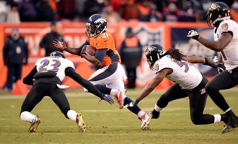 . Denver Broncos running back Ronnie Hillman (21) runs the ball against Baltimore Ravens defensive back Chykie Brown (23) during the third quarter.  The Denver Broncos vs Baltimore Ravens AFC Divisional playoff game at Sports Authority Field Saturday January 12, 2013. (Photo by John Leyba,/The Denver Post)