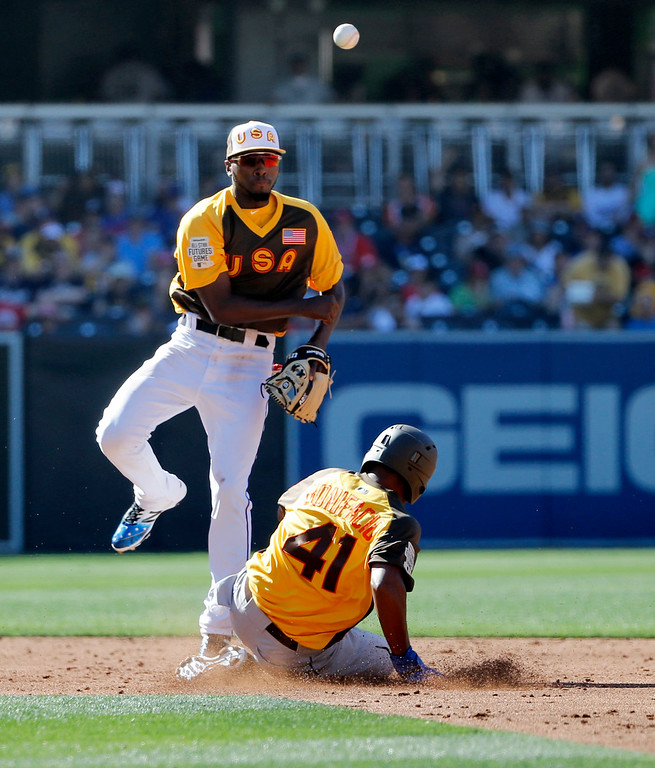 . U.S. Team\'s Travis Demeritte, of the Texas Rangers, forces out Jorge Bonifacio (41), of the Kansas City Royals, as he turns a double play on Willy Adames, of the Tampa Bay Rays, during the third inning of the All-Star Futures baseball game, Sunday, July 10, 2016, in San Diego. (AP Photo/Lenny Ignelzi)