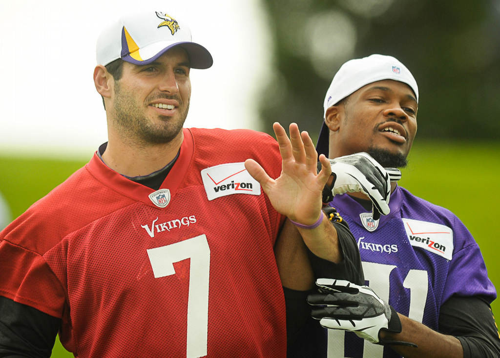 . Quarterback Christian Ponder, left, and wide receiver Jerome Simpson joke around as they leave the field after Friday morning\'s workout. (Pioneer Press: Ben Garvin)