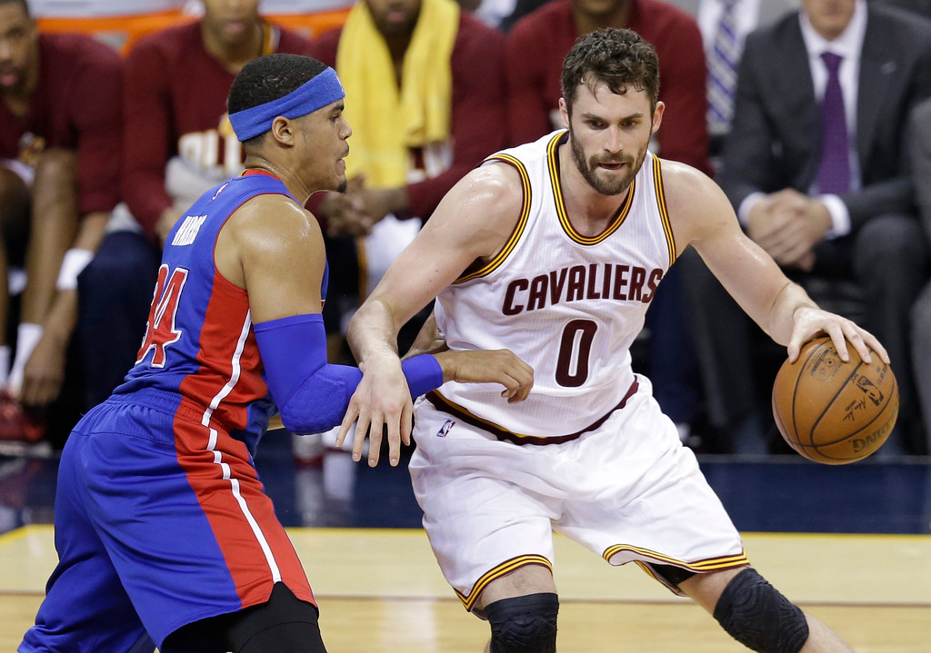 . Cleveland Cavaliers\' Kevin Love (0) drives past Detroit Pistons\' Tobias Harris (34) in the first half in Game 2 of a first-round NBA basketball playoff series, Wednesday, April 20, 2016, in Cleveland. (AP Photo/Tony Dejak)