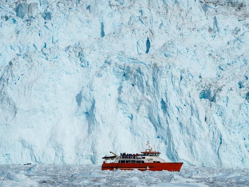 Boat next to Eqip Sermia glacier