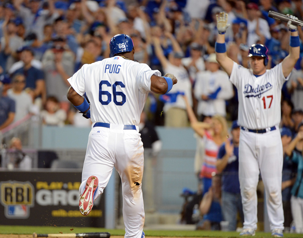 . Los Angeles Dodgers Juan Uribe homered to right and  Yasiel Puig scored  during game 3 of the NLDS at Dodger Stadium Sunday, October 6, 2013. (Photo by David Crane/Los Angeles Daily News)