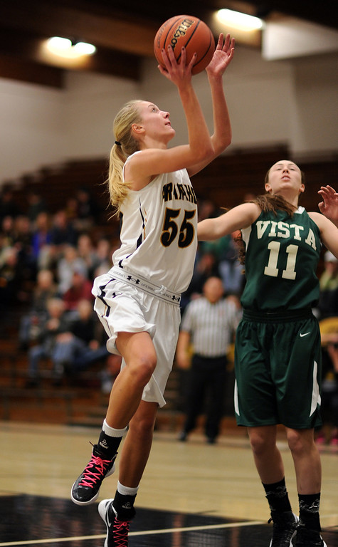 . Arapahoe\'s Molly Reidel (55), left, makes a basket by Mountain Vista\'s Paige Keller(11) in the second half of the game at Arapahoe High School Gym onSaturday, Jan. 5, 2013, in Centennial, Colo. Arapahoe won 74-38. Hyoung Chang, The Denver Post
