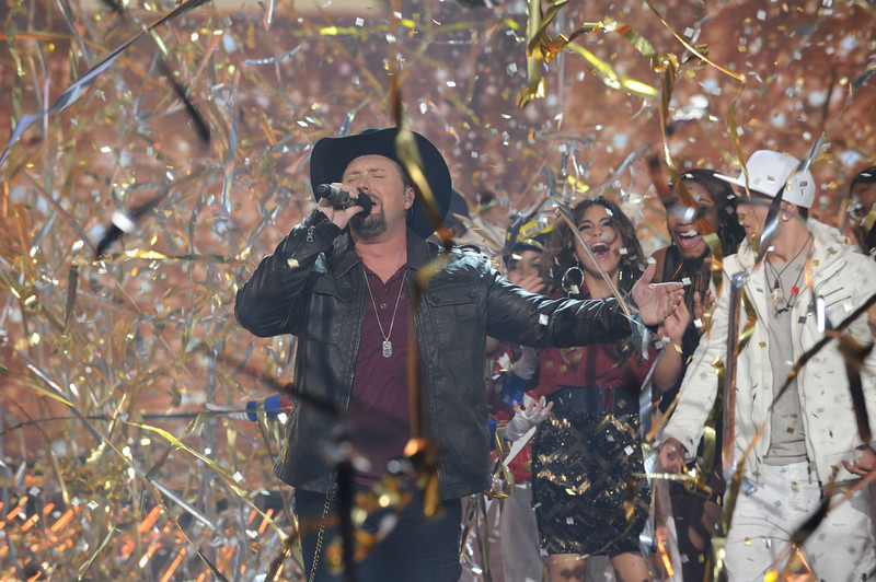 . In this Thursday, Dec. 20, 2012 publicity photo released by FOX  X FACTOR season two winner Tate Stevens performs during THE X FACTOR Finale Thursday night Dec. 22, 2012 on FOX. (AP Photo/FOX, Ray Mickshaw)