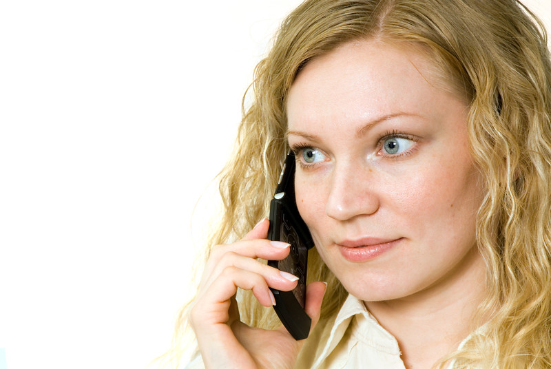 Woman talking on her cell phone.