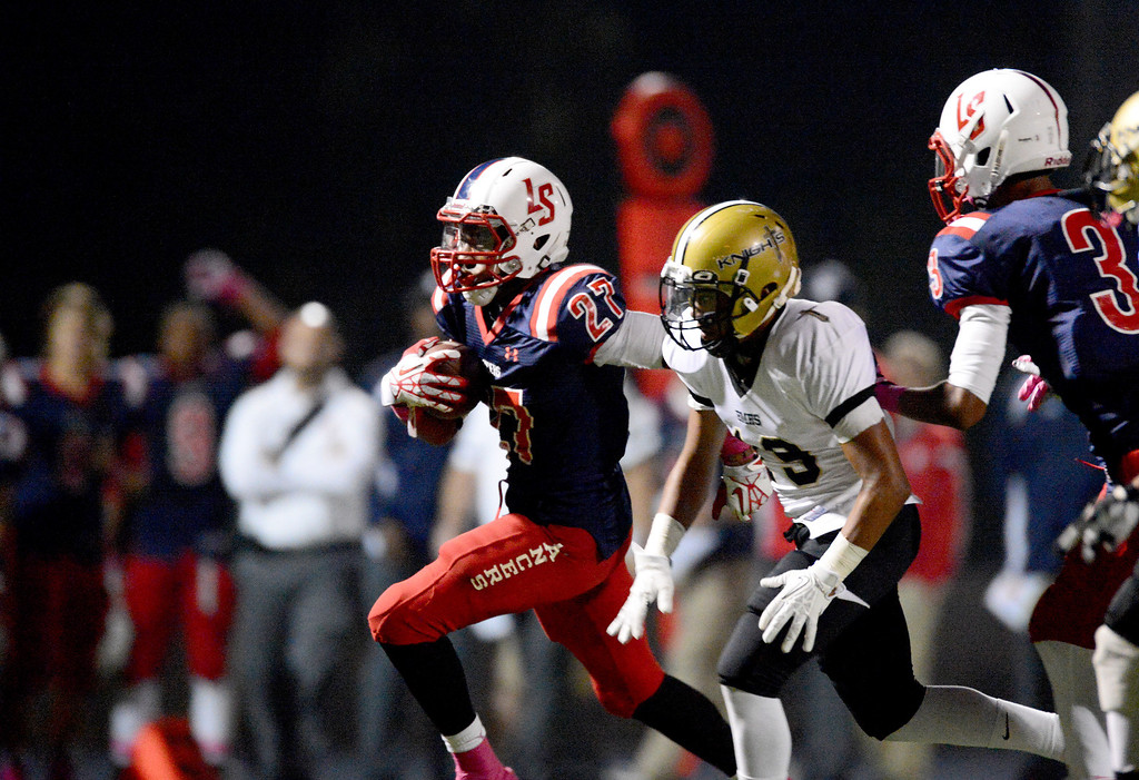 . La Salle\'s running back Milan Acquaah (27) gains yards as they play Bishop Montgomery during the second quarter in Friday night\'s football game at La Salle High School in Pasadena, October 25, 2013.  (Photo by Sarah Reingewirtz/Pasadena Star-News)