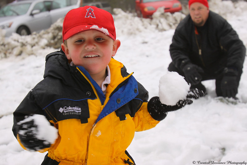 """December 12, 2009  Oliver's first day playing in the snow! He loved it!!! In his words, """"I lovvvvvvve Snow!"""""""