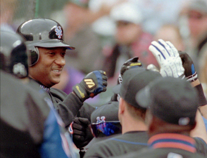 . New York Mets\' Darryl Hamilton is congratulated by teammates after scoring during the eighth inning against the Colorado Rockies at Coors Field in Denver, Wednesday, Sept. 15,1999. The Mets won 10-5. (AP Photo/Jack Dempsey)